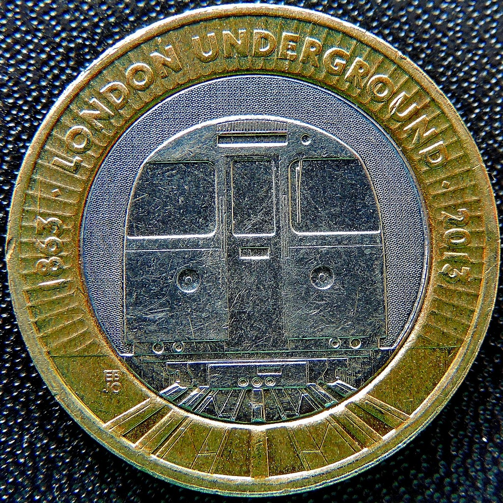 This coin was issued to mark the 150th anniversary of London Underground, but that train looks like Victoria line stock to me.